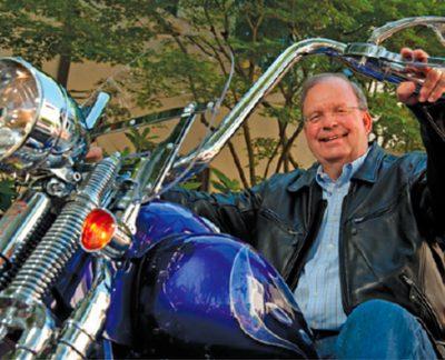 Chuck Toeniskoetter on Motorcycle