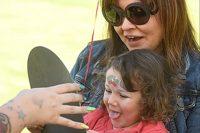 Fight Stroke Walk little girl getting face painted